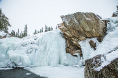 A beautiful landscape of a frozen waterfall in the snowy winter day Stock Photography