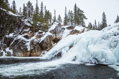 A beautiful landscape of a frozen waterfall in the snowy winter day Royalty Free Stock Photo