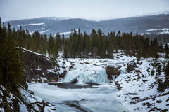 A beautiful landscape of a frozen waterfall in the snowy winter day Stock Photo