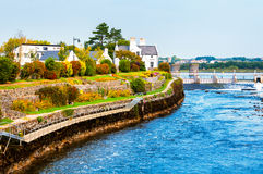 Beautiful landscape of Galway, Ireland. River and houses with clear blue sky Stock Photography