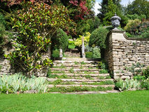 Beautiful Landscape Garden. Tranquil Landscape Garden Scene of a Freshly Mown Lawn and Steps to an Upper Level Royalty Free Stock Images
