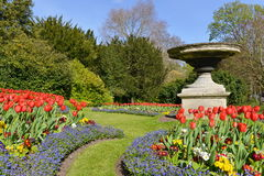 Beautiful Landscape Garden. Scenic View of Flowerbeds, Grass Pathway and Ornamental Vase in a English Landscape Garden Stock Images