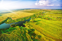 Beautiful landscape with green fields and lake Royalty Free Stock Image