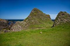 Beautiful landscape, green hills of Ireland at Ballintoy sea shore Stock Photos