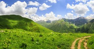 Beautiful landscape of green mountains in Georgia, Svaneti. Scenic view on hills and mountain on vibrant summer day stock image