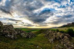 Beautiful landscape with green vegetation, rocks and a blue sunset sky with clouds. Dobrogea, Romania stock photos