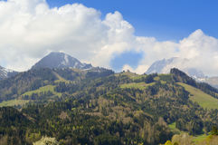 Beautiful landscape in Gruyeres with blue sky and clouds. Mountain panorama from Canton Fribourg, Gruyeres, Switzerland Royalty Free Stock Photos