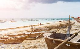 Beautiful landscape with hammock hanging on palm and boats in oc. Beautiful colorful landscape with hammock hanging on palm and boats in ocean on the background Royalty Free Stock Image