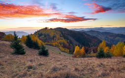A beautiful landscape with high mountains, sky with clouds and sunset. Location place Carpathians Ukraine Europe. Sunny day. stock photo