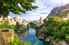 Beautiful landscape of the historic town of Mostar in the lights of the sunset, valley of the Neretva River Royalty Free Stock Photo