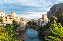 Beautiful landscape of the historic town of Mostar in the lights of the sunset, valley of the Neretva River Royalty Free Stock Photos