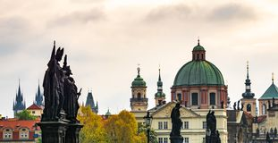 Beautiful landscape of the historical center of Prague. Statues on the bridge and Cathedral in the background royalty free stock image