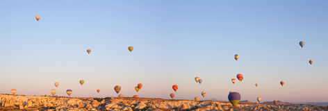 Beautiful landscape with hot air balloons and mountains Royalty Free Stock Images