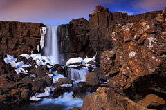 Beautiful landscape from Iceland. Öxarárfoss waterfall before sunrise. Water in the rock. Winter scene with snow, stone and wate Royalty Free Stock Images