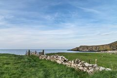 Beautiful landscape image of Dunstanburgh headland in Northumber Royalty Free Stock Photo