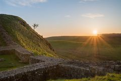 Beautiful landscape image of Hadrian`s Wall in Northumberland at. Stunning landscape image of Hadrian`s Wall in Northumberland at sunset with fantastic late Royalty Free Stock Image