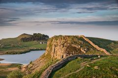 Beautiful landscape image of Hadrian`s Wall in Northumberland at. Stunning landscape image of Hadrian`s Wall in Northumberland at sunset with fantastic late Royalty Free Stock Photos