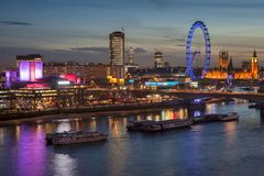 Beautiful landscape image of the London skyline at night looking Royalty Free Stock Image