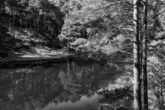 Beautiful landscape image of old clay pit quarry lake in black a Royalty Free Stock Photography