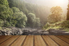 Beautiful landscape image of sunlight streaming through trees in Royalty Free Stock Photography