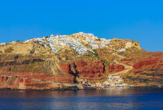 Beautiful landscape of island Santorini with the town of Oia on top of the volcanic hill. Royalty Free Stock Photo