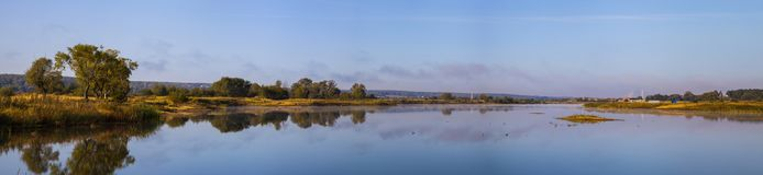Lake early in the morning. Beautiful landscape. Lake early in the morning with a fog. Panorama Royalty Free Stock Image