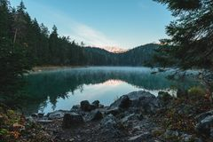 Beautiful landscape with a lake Eibsee in the mountains in the Bavarian Alps in the morning, Germany royalty free stock image