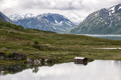 Beautiful landscape with lake, house trees and mountains, central Norway Royalty Free Stock Images