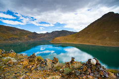 Beautiful landscape with lake, mountain and pile of stone in Tibet Royalty Free Stock Photography