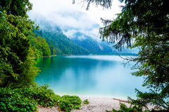 Beautiful landscape, lake with mountain in summer rain. Royalty Free Stock Photography
