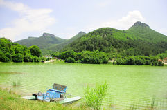 Beautiful landscape with lake and mountains. And catamaran Stock Photography