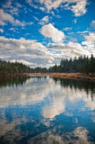 reflections of cloudscape in wild lake Royalty Free Stock Image