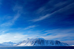 Beautiful landscape. Land of ice. Cold blue water nature. Rocky island with snow. White snowy mountain, blue glacier Svalbard, Nor. Way stock photos