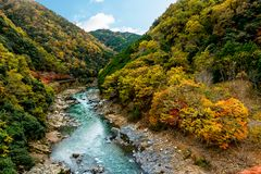 Landscape the Katsura River in autumn. The beautiful landscape landmark of the Katsura river and with the Togetsukyo Bridge in the distance, in Arashiyama area Royalty Free Stock Images