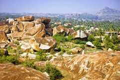 Beautiful landscape with large rocks near Hampi, India. Beautiful landscape with large steep rocks, palm trees and bushes near Hampi, India Royalty Free Stock Image