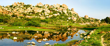 Beautiful landscape with large rocks near Hampi, India. Beautiful landscape with large steep rocks, trees and bushes near Hampi, India Royalty Free Stock Photos
