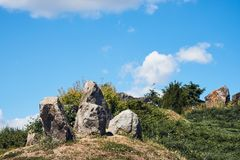 Beautiful landscape with large stones, hills, flowers stock images