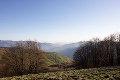 Landscape of ligurian apennines at sunset in spring. Beautiful landscape of ligurian apennines and valley at sunset in spring Royalty Free Stock Images