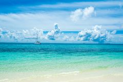 Beautiful landscape with luxury sail catamaran. On the clear turquoise water of Indian ocean Maldives islands Stock Photos