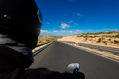 Landscape of Malta with tourists. Beautiful landscape of Malta island and tourist traveling on motorbike. Beautiful landscape in south Europe Royalty Free Stock Photo