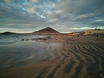 Red Mountain in El Medano beach, Tenerife, Canary islands, Spain stock photography