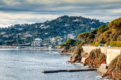 Beautiful landscape, Mediterranean Sea, Côte d`Azur, France, cl. Oudy weather, green pines over water Stock Photography