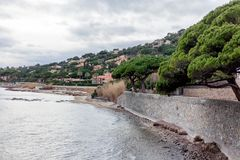Beautiful landscape, Mediterranean Sea, Côte d`Azur, France, cl. Oudy weather, green pines over water Stock Photos