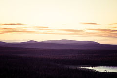 A beautiful landscape with a midnight sun above arctic circle. Stock Images