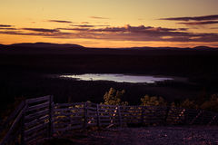 A beautiful landscape with a midnight sun above arctic circle. Stock Image