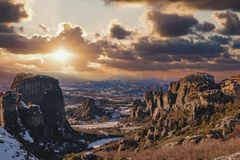Beautiful landscape with monasteries and rock formations in Meteora during sunset, Greece royalty free stock photos