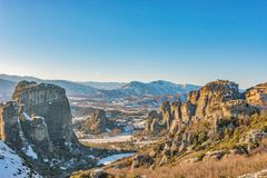 Beautiful landscape with monasteries and rock formations in Meteora in winter time, Greece stock photos