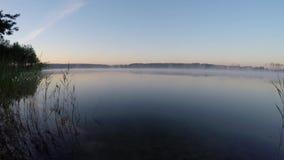 Beautiful landscape - morning haze moving across  pond stock video footage
