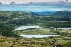 Beautiful landscape, mountain lake, green valley, blue sky stock images