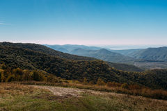 Beautiful landscape of a mountain ridge and a blue sky in the summer season. Marcothsky Range, Gelendzhik, Russia Royalty Free Stock Photos